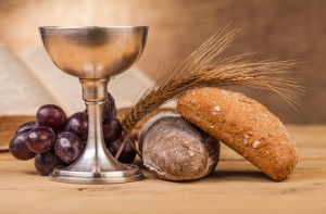 holy-communion-composition-chalice-wooden-table-63793930